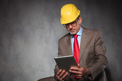 Entrepreneur wearing helmet and glasses while seated Royalty Free Stock Images