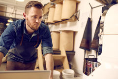 Entrepreneur working in his neat and modern coffee roastery Royalty Free Stock Photos