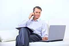 Entrepreneur working from home looking Stock Images
