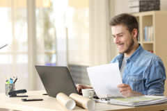 Entrepreneur working with laptop and document royalty free stock photography