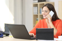 Entrepreneur working with multiple devices Royalty Free Stock Images