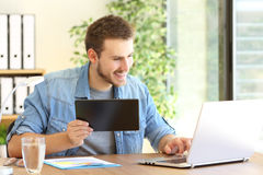 Entrepreneur working with tablet and laptop Royalty Free Stock Photography