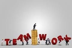 Entrepreneurs arrange a teamwork text Royalty Free Stock Photos