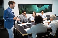 Entrepreneurs and business people conference in meeting room. Entrepreneurs and business people conference in modern meeting room stock photography