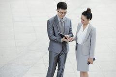 Entrepreneurs checking data on tablet royalty free stock photos