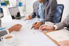 Entrepreneurs discussing blueprint stock photo