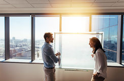 Entrepreneurs discussing business ideas  in office. Business investors discussing business plans in boardroom. Men and women entrepreneurs in office discussing Stock Photography