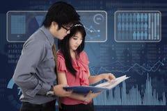 Entrepreneurs and futuristic interface Royalty Free Stock Photos