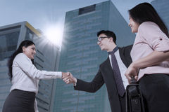 Entrepreneurs handshaking near the office building Stock Image