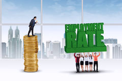 Entrepreneurs lift an employment rate text Royalty Free Stock Image