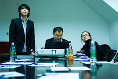 IT entrepreneurs meeting. IT entrepreneurs in the meeting in the office of Guanghai building, in Zhongshan road guangzhou. They are the CEO QiDing and designers Royalty Free Stock Images