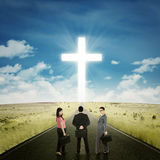 Entrepreneurs on the road with a cross Stock Image