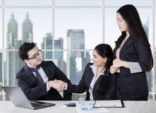 Entrepreneurs shaking hands finishing the meeting Stock Photo