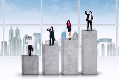 Entrepreneurs standing on business graph Stock Image