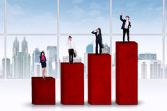 Entrepreneurs standing over business graph Royalty Free Stock Photography