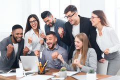 Entrepreneurs team celebrating victory in office. Successful diverse entrepreneurs celebrating victory in office royalty free stock image