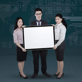 Entrepreneurs with whiteboard and financial background Royalty Free Stock Photography