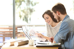 Entrepreneurs working with forecasting graphic Stock Images