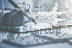 Entrepreneurship concept. Side view and close up of female hand writing in notepad at workplace with creative rocket sketch. Entrepreneurship concept. Black and Stock Image