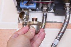 Entretien de chauffe-eau de gaz Photographie stock