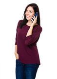 Entretien de femme de brune au téléphone portable Image libre de droits