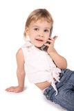 Entretien de fille sur le téléphone portable Images stock