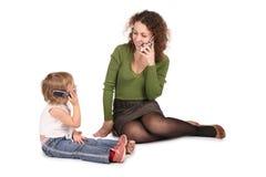 Entretien de mère et de descendant sur la cellule Photo libre de droits