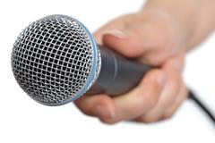 Entrevista con el micrófono Foto de archivo libre de regalías