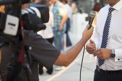 Entrevista de los media Imagen de archivo