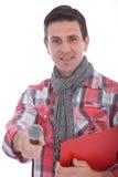 Entrevistador de sorriso que guarda para fora um microfone imagens de stock royalty free