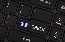 Entrez dans le bouton avec le concept de la Grèce de drapeau de la langue Photographie stock libre de droits