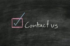 Entrez en contact avec nous et le bouton photographie stock