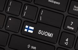 Entri nel bottone con la bandiera Finlandia - concetto della lingua Fotografia Stock