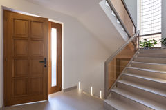 Entry of an apartment. Staircase and white walls royalty free stock photos