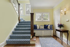 Entry area with yellow walls. Entry area of luxury home with yellow walls Royalty Free Stock Images