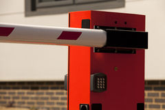 Entry barrier. A close up photo of a security entry barrier in a company car park royalty free stock photography