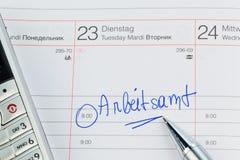Entry in the calendar: employment office Stock Photos