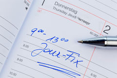 Entry in the calendar: jour fix. An appointment is entered on a calendar: jour fix Stock Photos