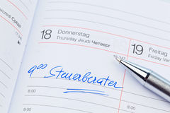 Entry in the calendar: tax consultant Royalty Free Stock Photos