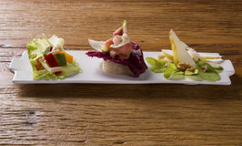 Entry dish with parma ham, fig, pear, purple lettuce and fresh g Royalty Free Stock Image