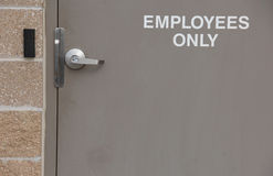 Entry door for Employees Only. Employees Only taupe door entrance with card key Royalty Free Stock Image