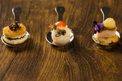 Entry, entree and dessert of finger food in a spoon. Royalty Free Stock Photography