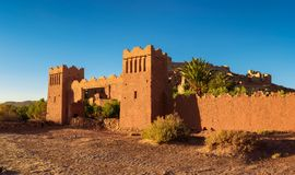 Entry gate of Ait Benhaddou in Morocco at sunset royalty free stock image