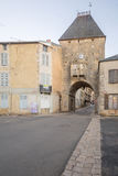 The entry gate porte dAvallon, Noyers-sur-Serein. NOYERS-SUR-SEREIN, FRANCE - OCTOBER 12, 2016: Sunrise view of the entry gate porte dAvallon, in the medieval Stock Photography