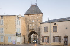 The entry gate porte dAvallon, Noyers-sur-Serein. NOYERS-SUR-SEREIN, FRANCE - OCTOBER 12, 2016: Sunrise view of the entry gate porte dAvallon, in the medieval Royalty Free Stock Images