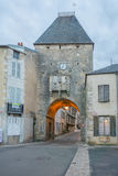 The entry gate porte dAvallon, Noyers-sur-Serein. NOYERS-SUR-SEREIN, FRANCE - OCTOBER 11, 2016: Sunset view of the entry gate porte dAvallon, in the medieval Royalty Free Stock Photo