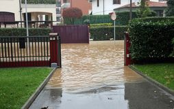Entry of a House during a flood and flooded road Stock Photo