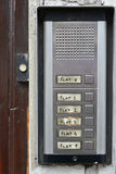 Entry intercom buttons to flats. Entry intercom push buttons to numbered flats beside door bell Royalty Free Stock Photos