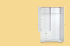 Entry open white wardrobe isolated on yellow background Royalty Free Stock Photos