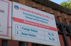 Entry price list discrimination Kathmandu Nepal. Ratna Park entry fee display price difference between Foreigner and Asian visitors in Kathmandu Nepal royalty free stock images